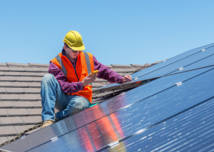 worker and solar panels - 465047912